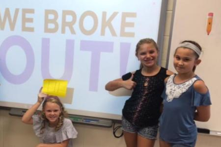 students in front of smart board with breakout EDU