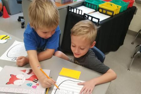 students working together on writing